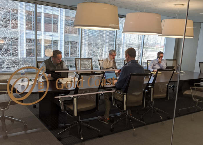 Bankers work in a conference room